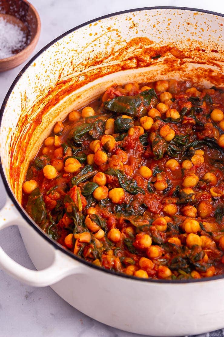 White pot of chickpea and spinach curry