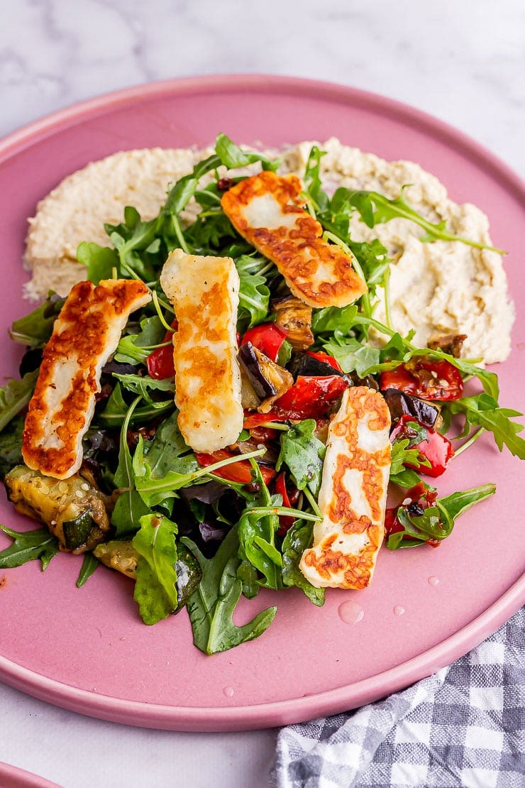 Close up of veggie salad with halloumi and hummus