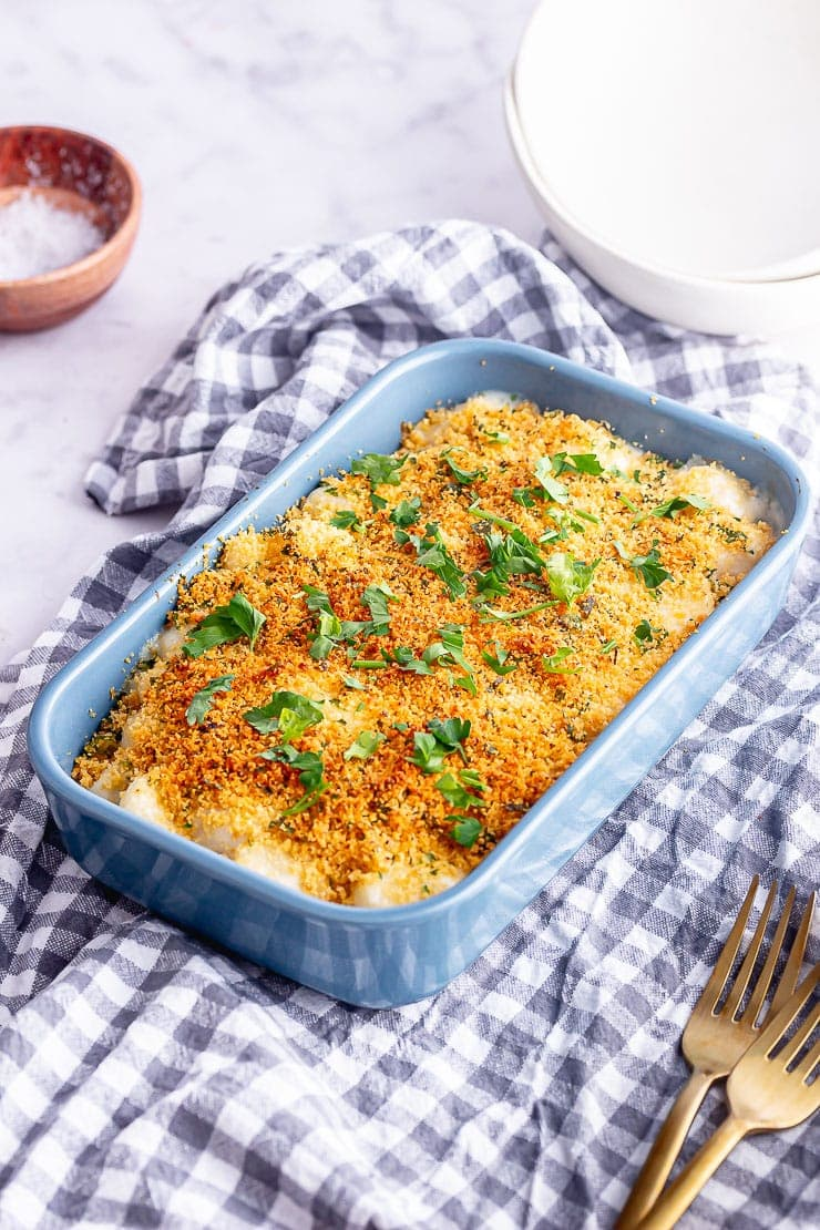 Blue baking dish with gnocchi and cheese with breadcrumb topping