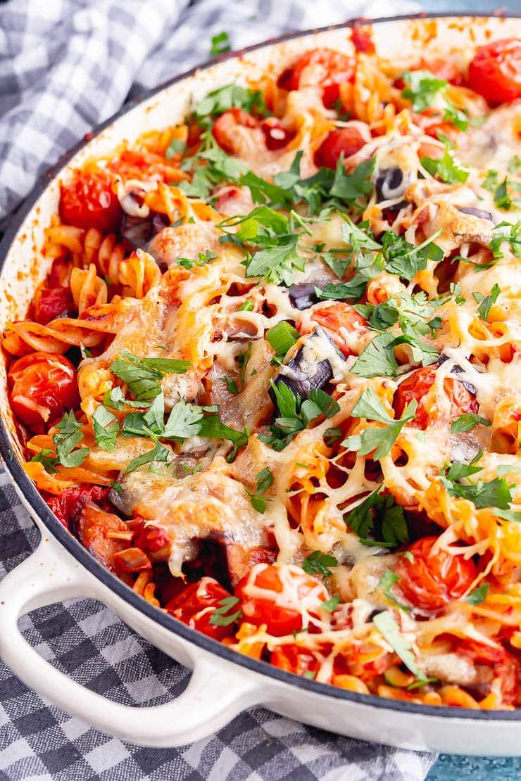 Close up of baked pasta in a white baking dish