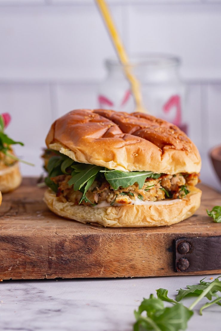 Tuna burgers on a wooden board over a marble background