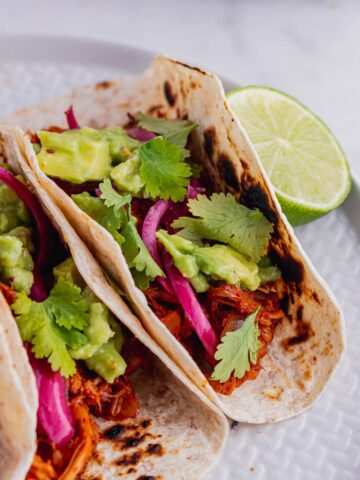 Close up of jackfruit tacos with lime and coriander
