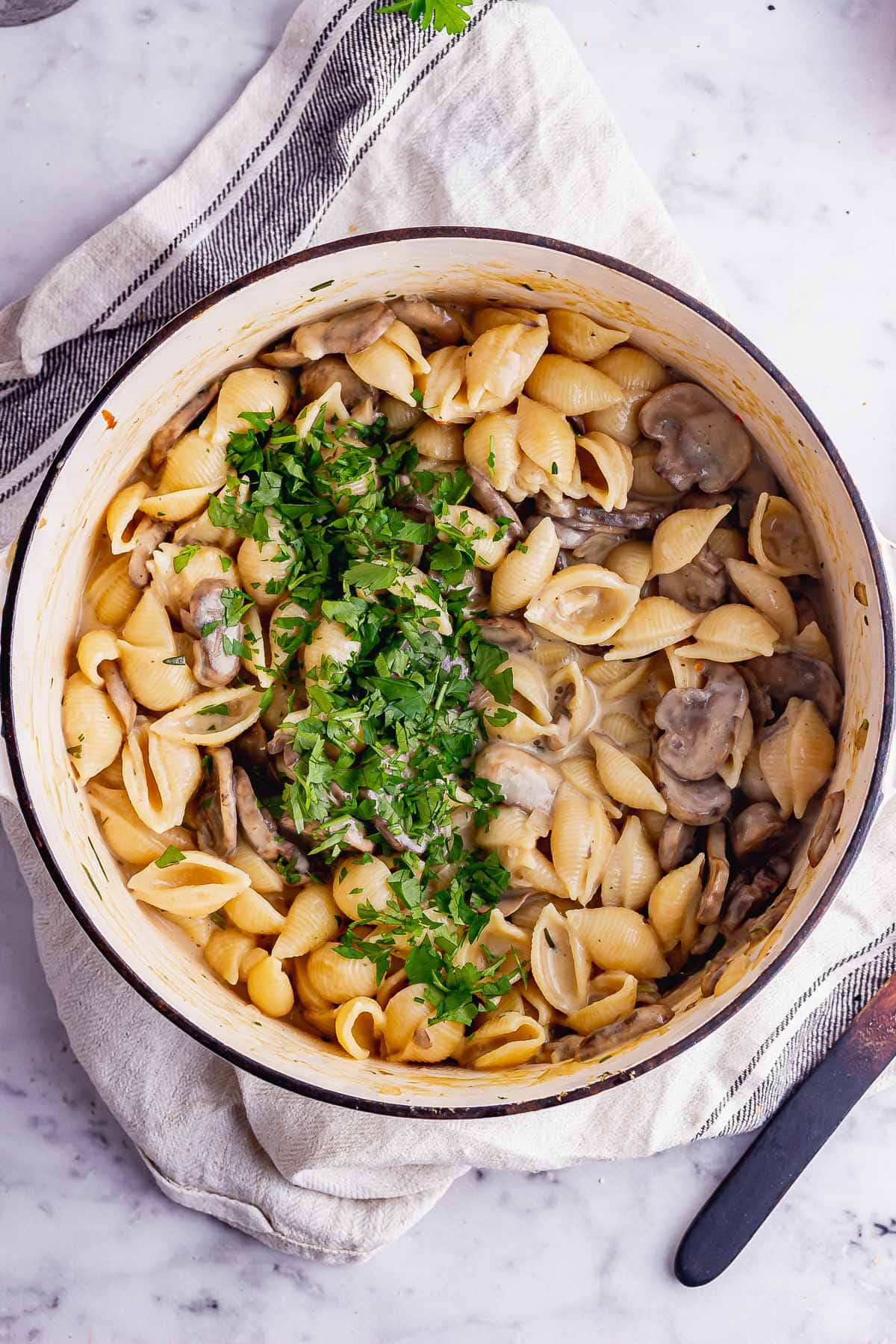 Overhead shot of vegetarian stroganoff with pasta in a white pot
