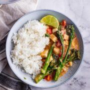 Overhead shot of peanut butter curry with broccoli and rice