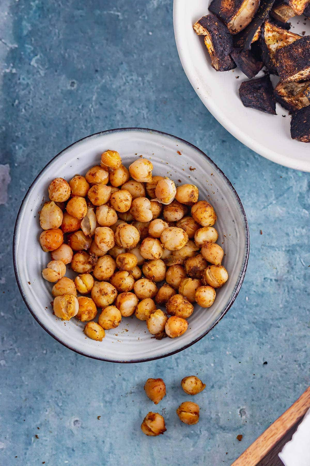 Overhead shot of a blue bowl of roasted chickpeas for a vegan pitta