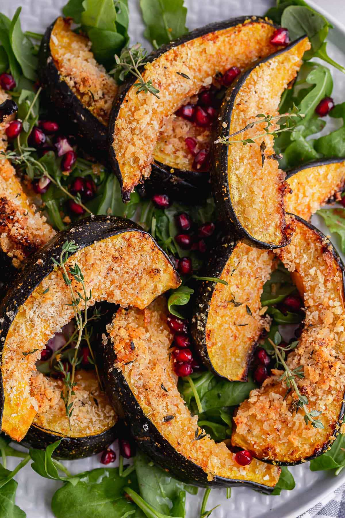 Close up of panko crumbed squash with pomegranate