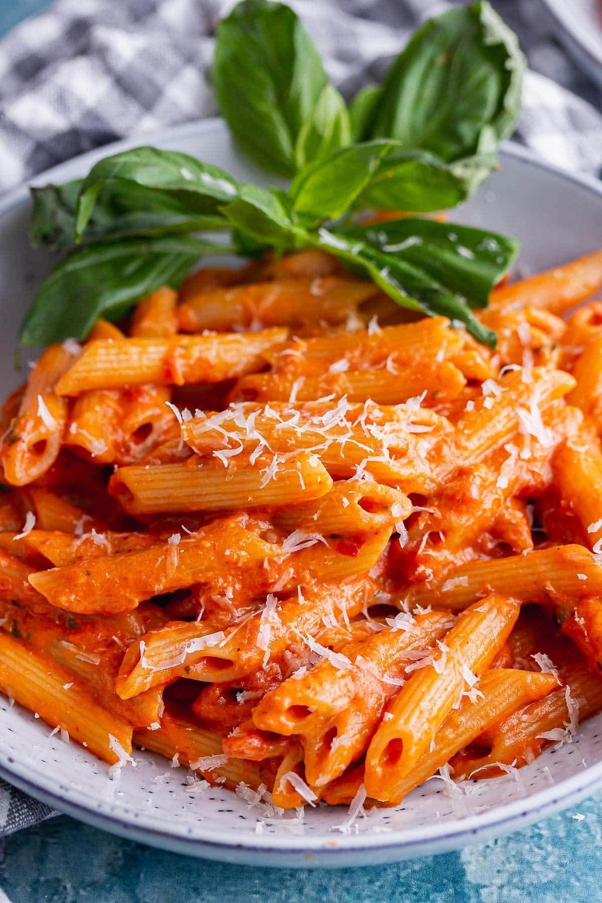 Close up of vodka sauce with pasta in a blue bowl