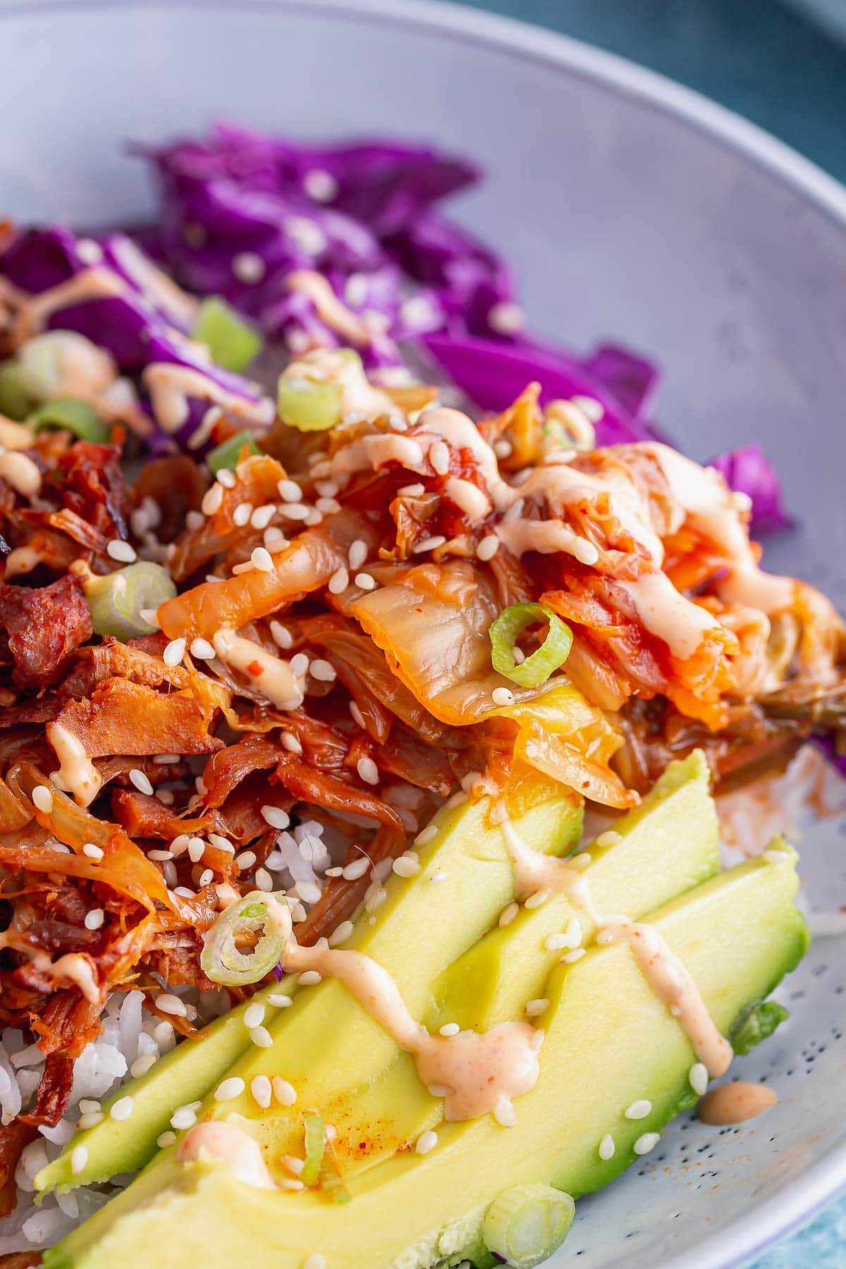 Close up of avocado and kimchi on a BBQ rice bowl