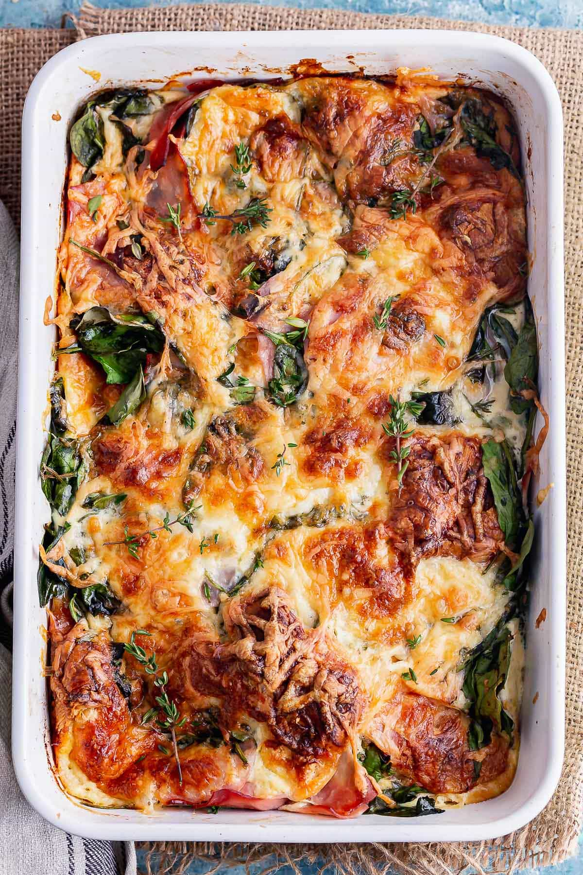 Overhead shot of cheesy breakfast casserole with spinach