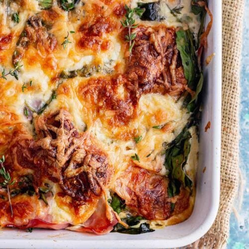 Breakfast bake with ham and cheese on a blue background