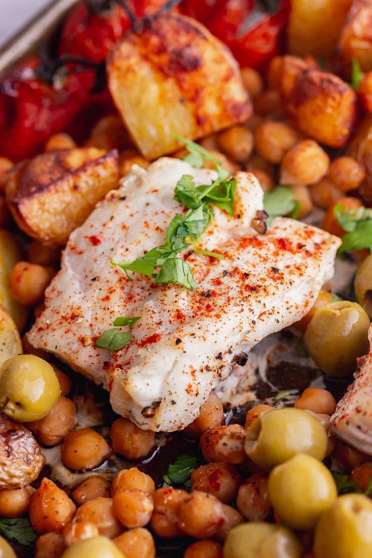 Close up of cod with chickpeas and potatoes