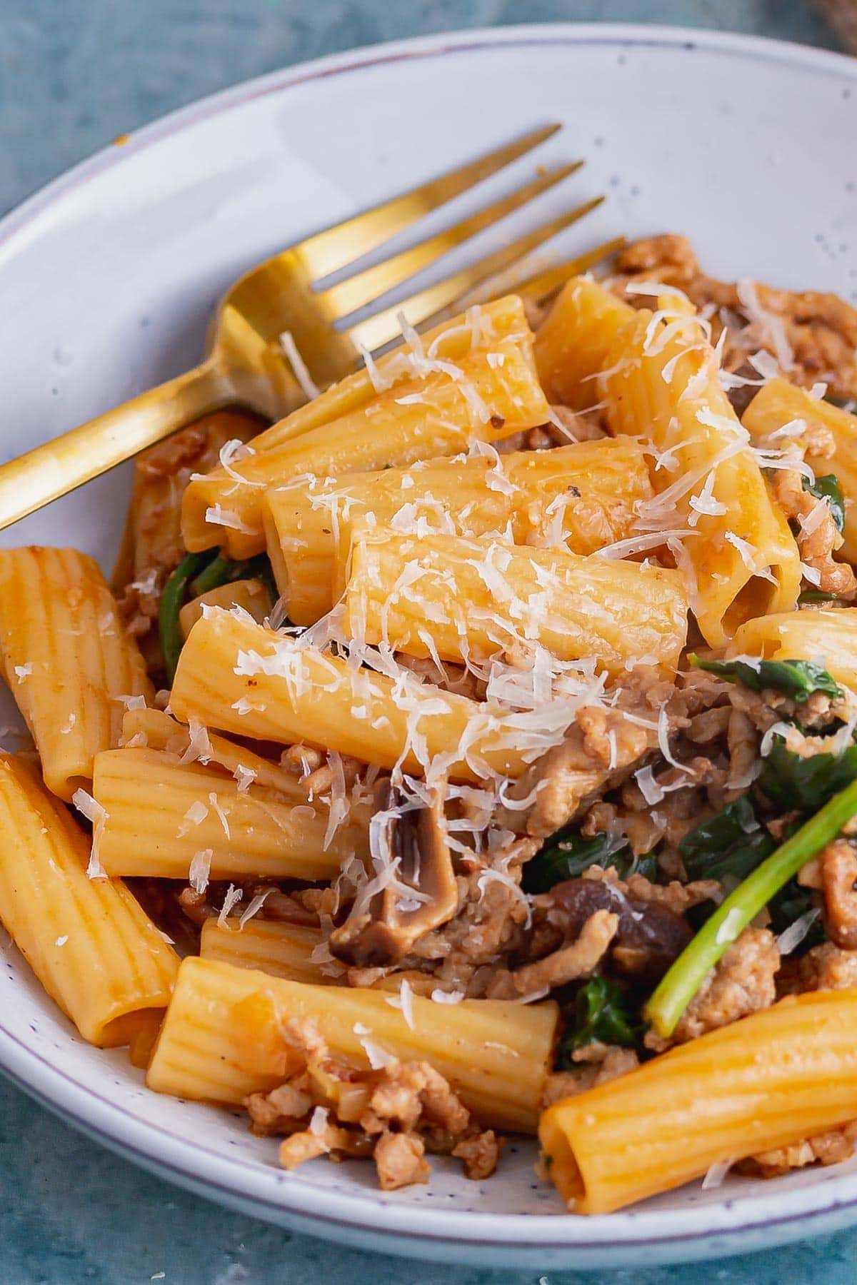 Close up of pork mince pasta in a blue bowl