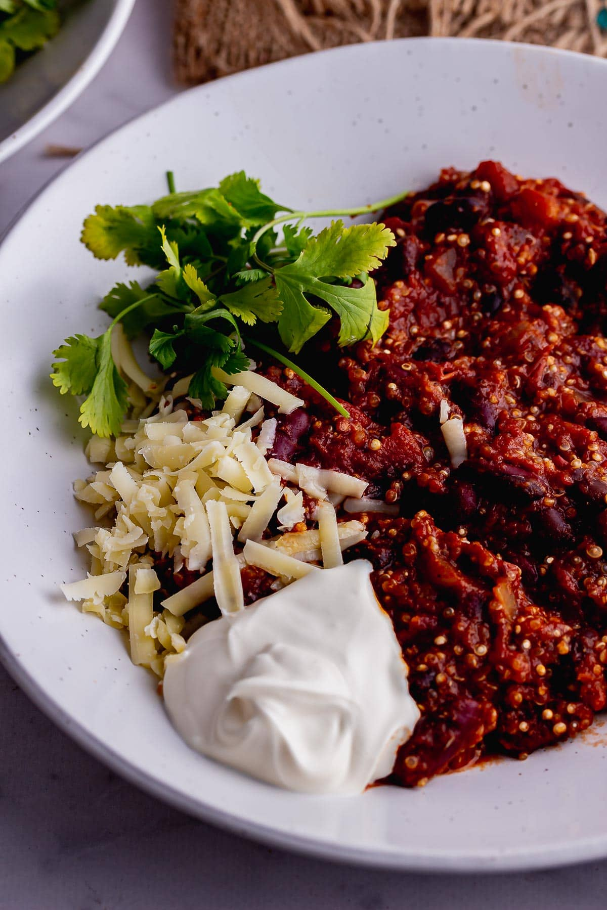 Close up of vegan chilli with toppings