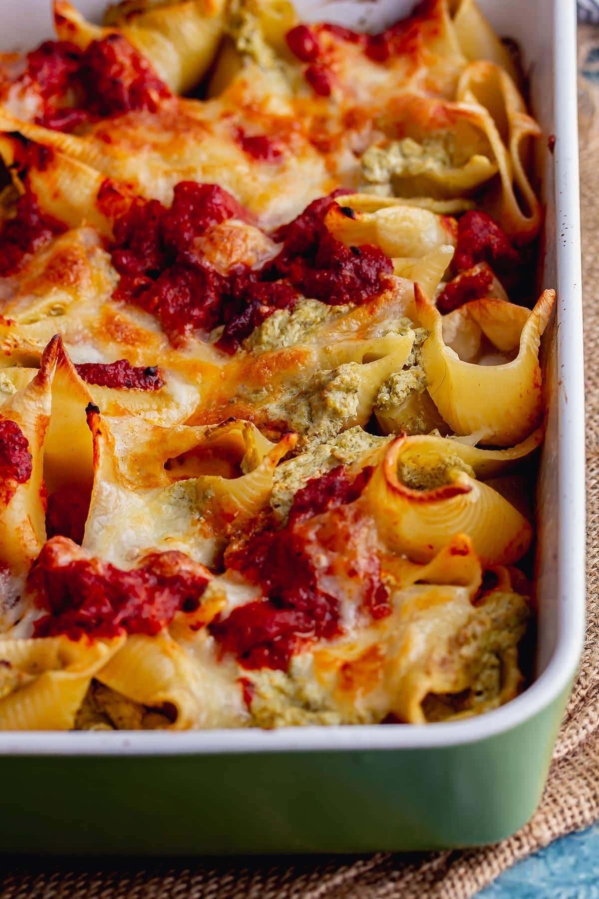 Close up of stuffed pasta shells in a baking dish