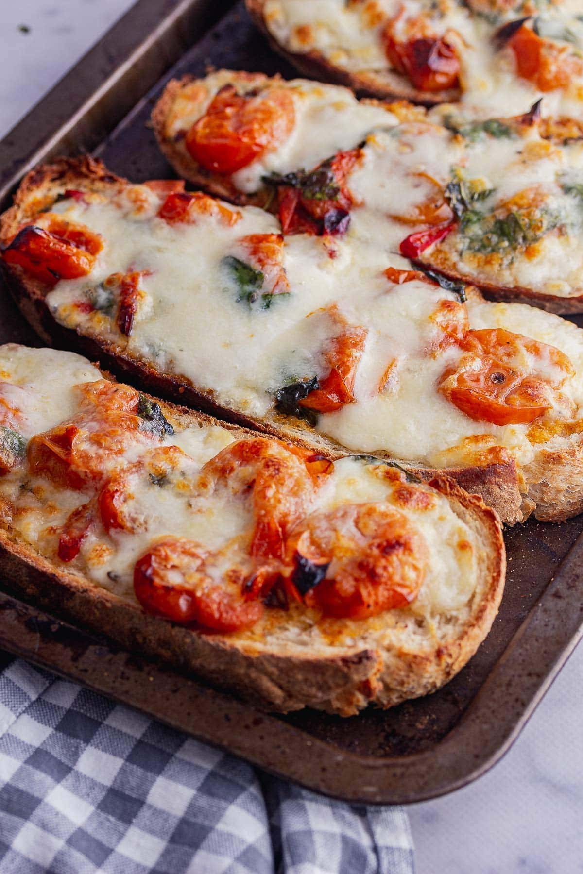 Close up of tomato and mozzarella toasts on a marble background
