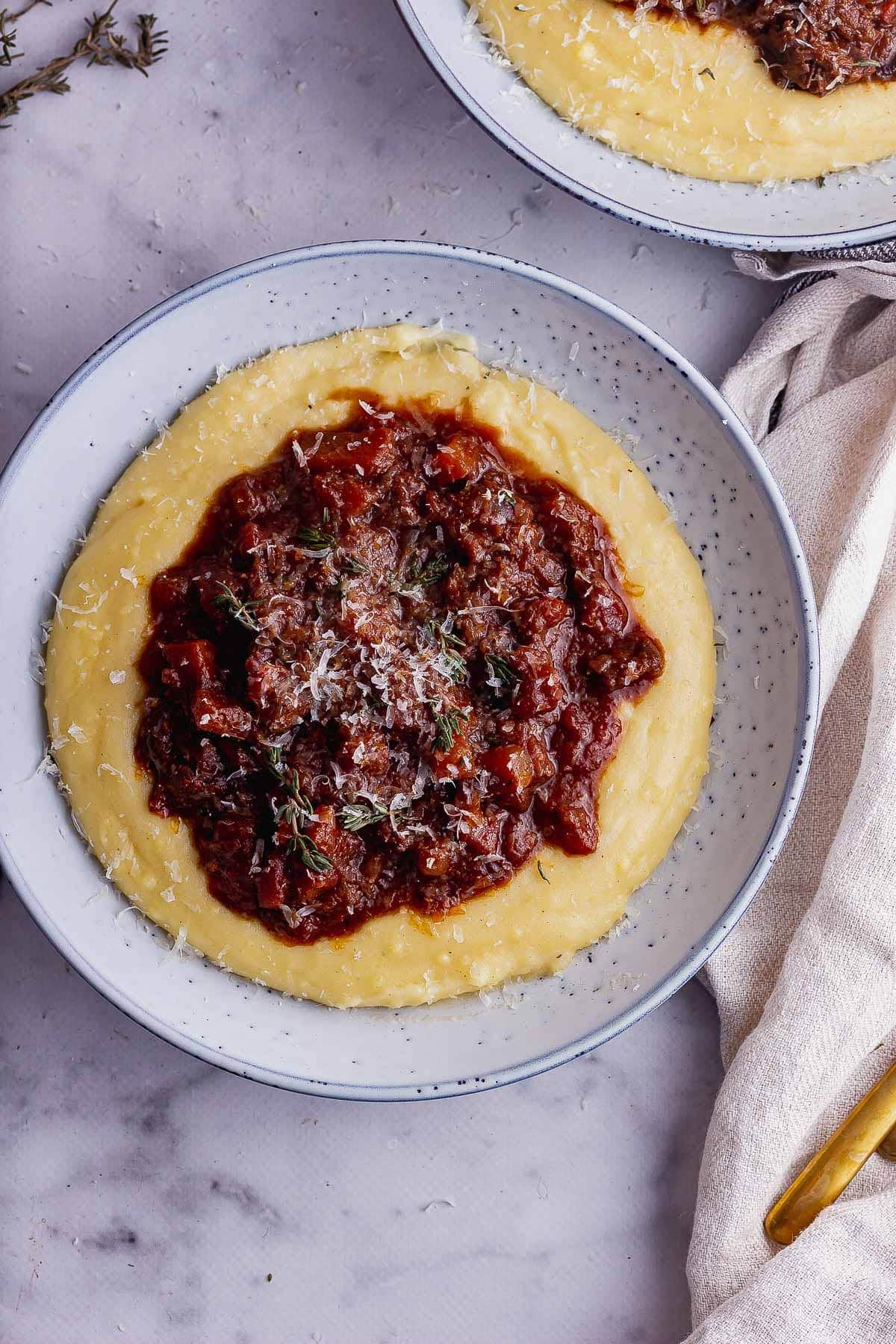 Overhead shot of slow cooked beef on polenta