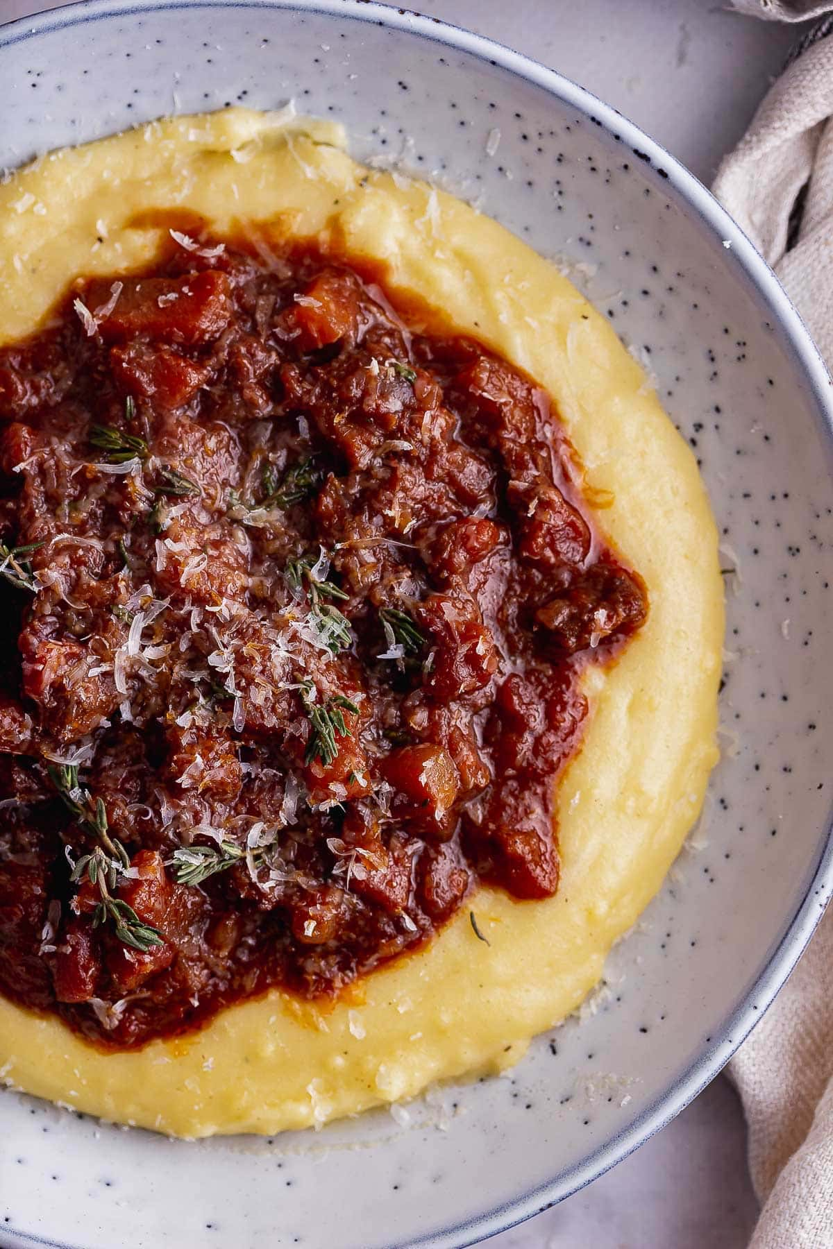Overhead close up of braised beef stew on polenta