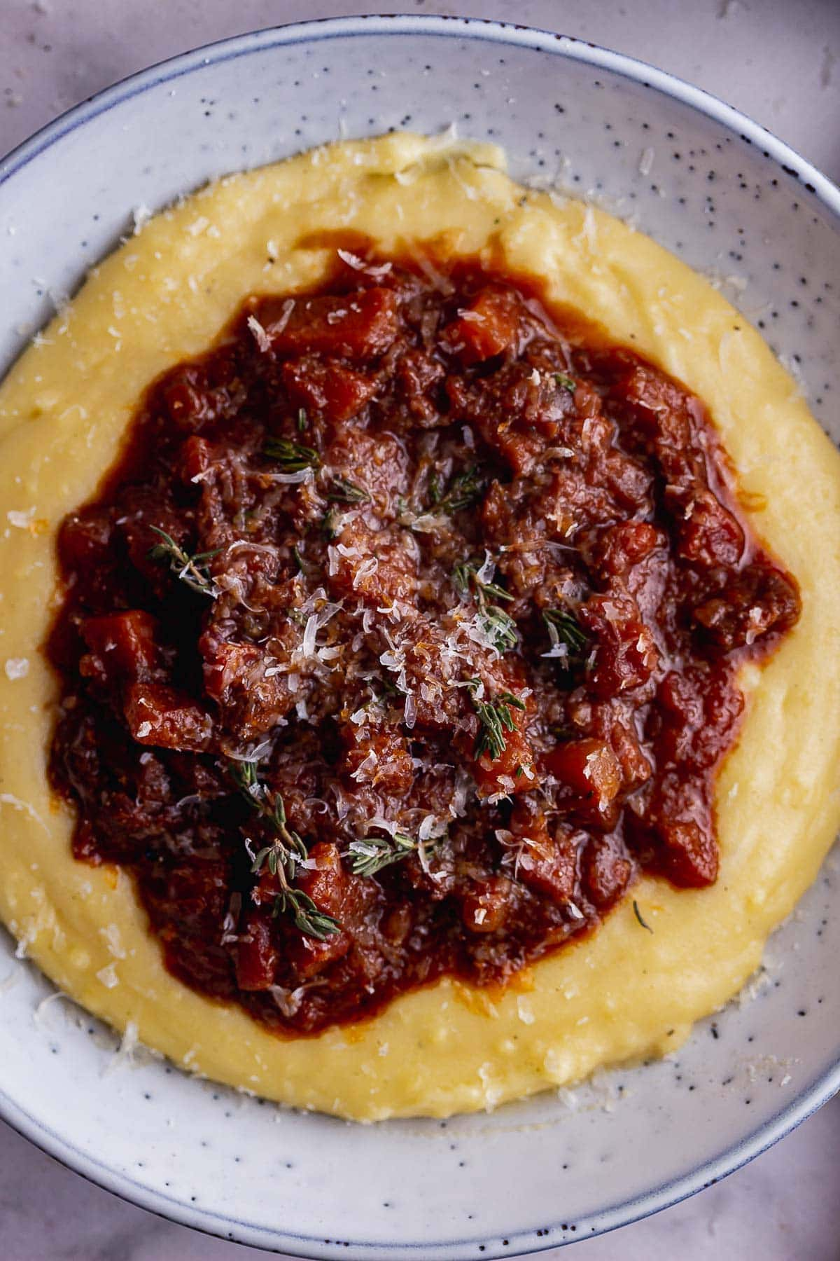Overhead shot of beef bolognese sauce on polenta