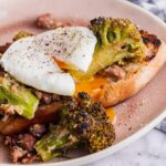 Roasted broccoli and beans on toast with a poached egg