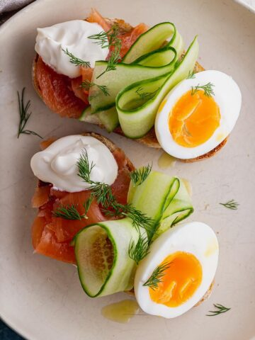 Close up overhead shot of breakfast toasts in a white bowl