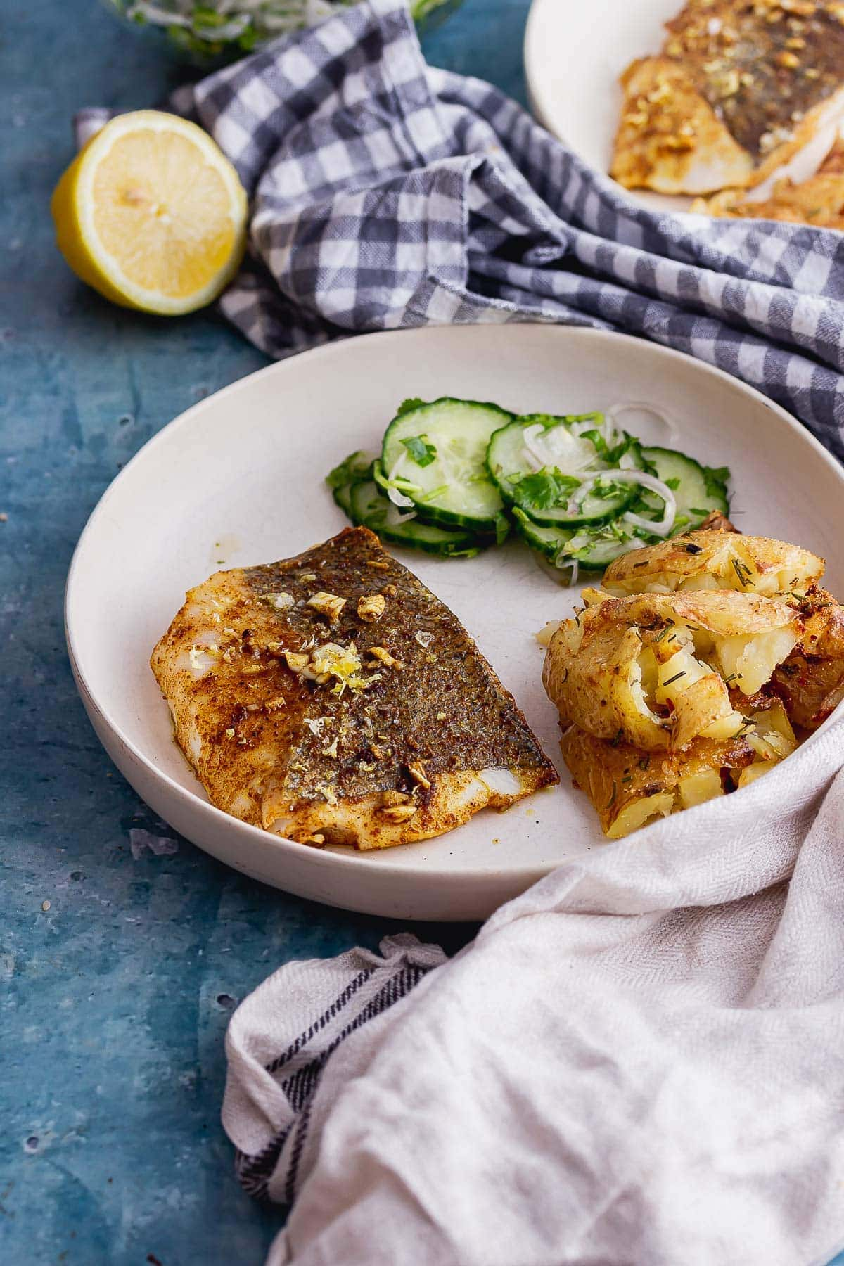 Spiced baked fish on a blue background