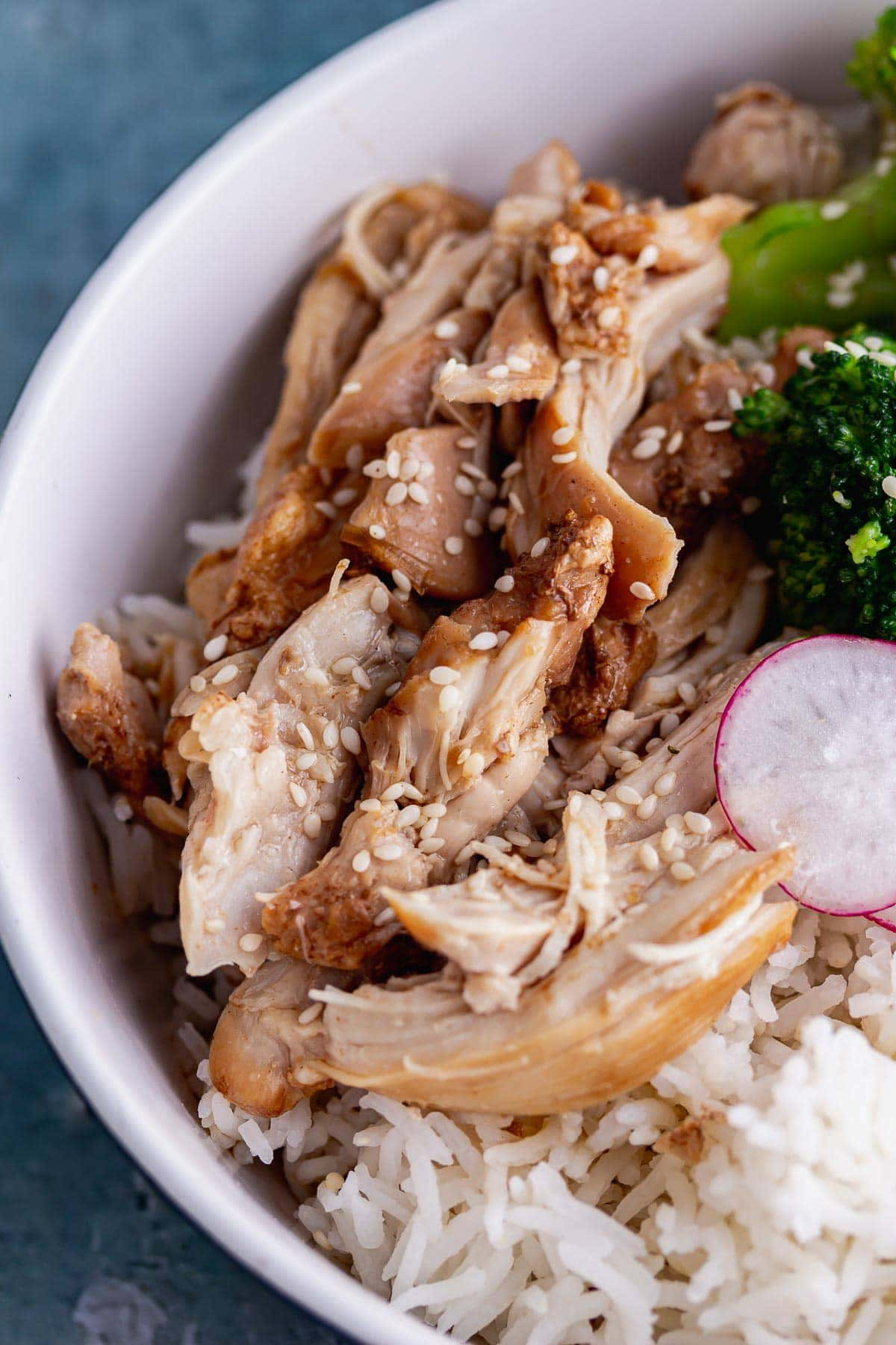Close up of shredded chicken in a bowl