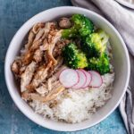 Overhead shot of soy braised chicken with rice and vegetables