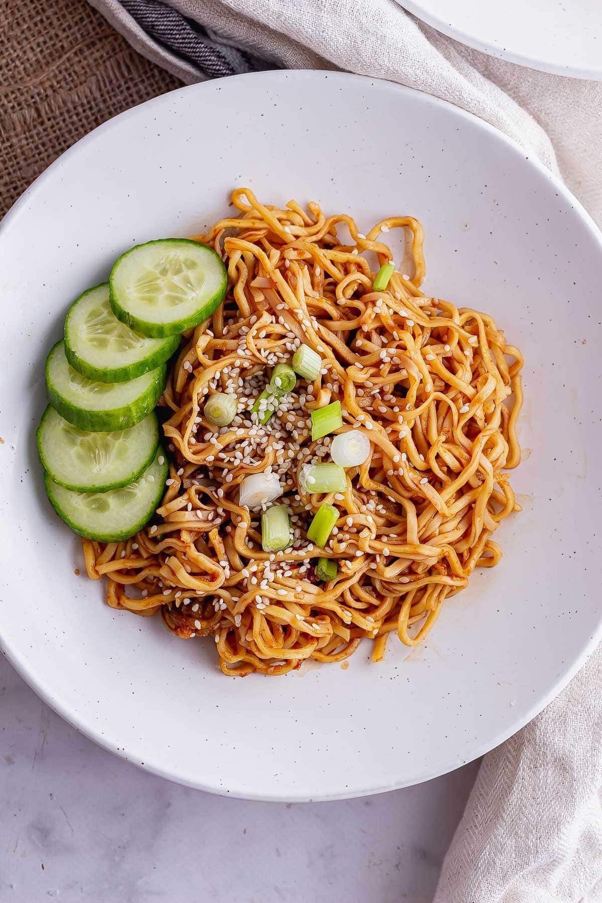Overhead shot of cold peanut noodles with cucumber