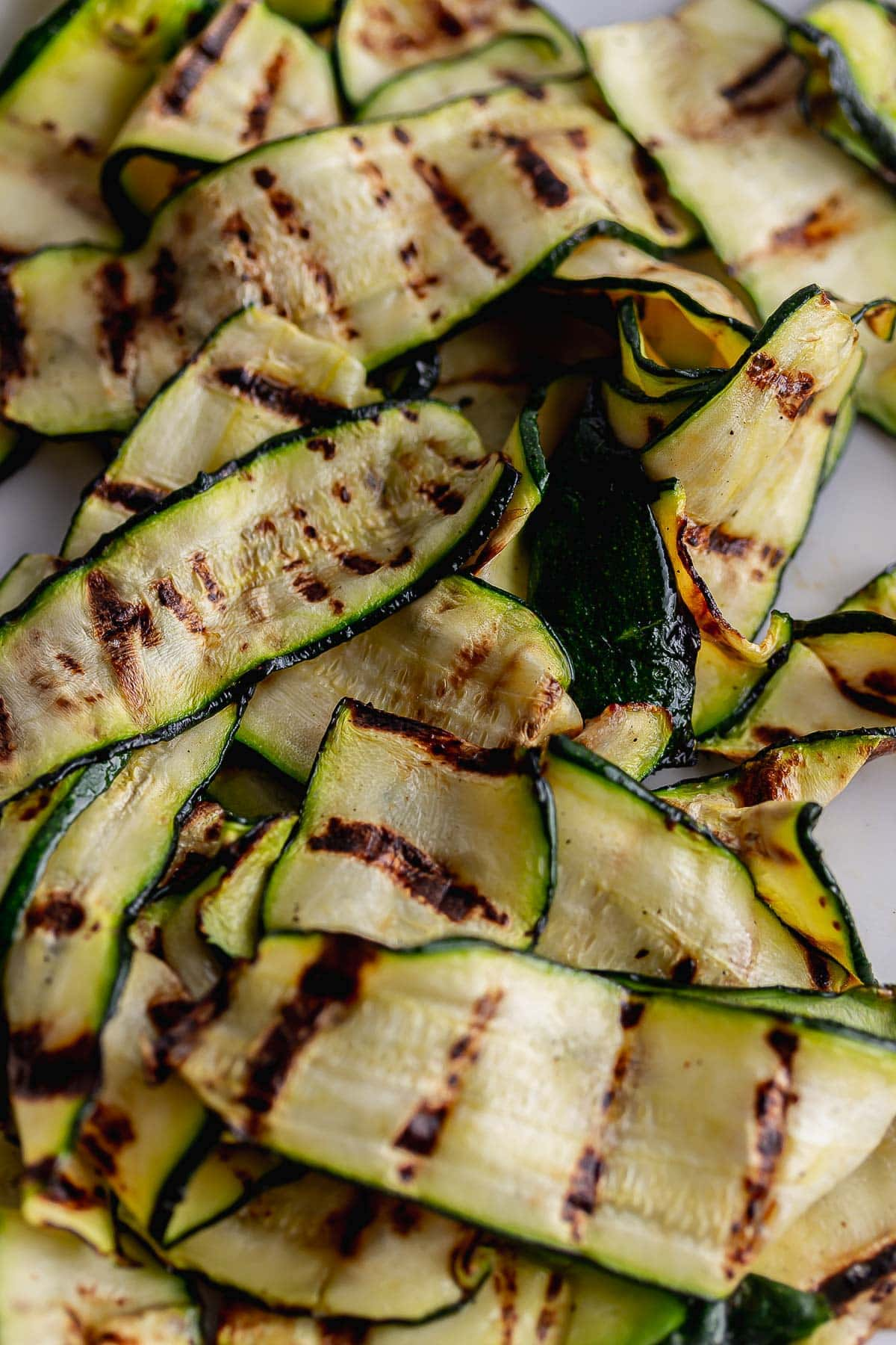 Close up of charred courgette slices
