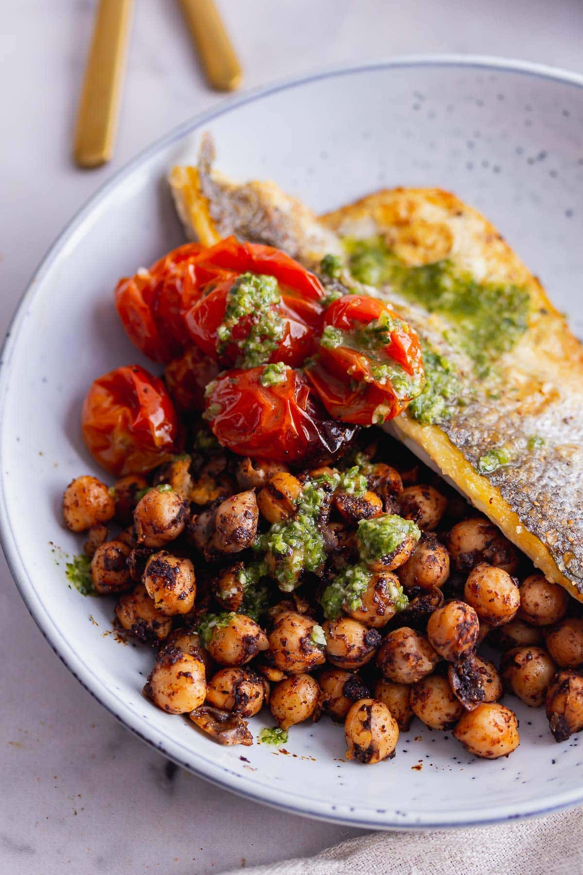Close up of spiced chickpeas and roasted tomatoes