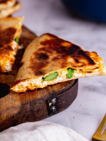 Close up of cheese and broccoli in flatbreads