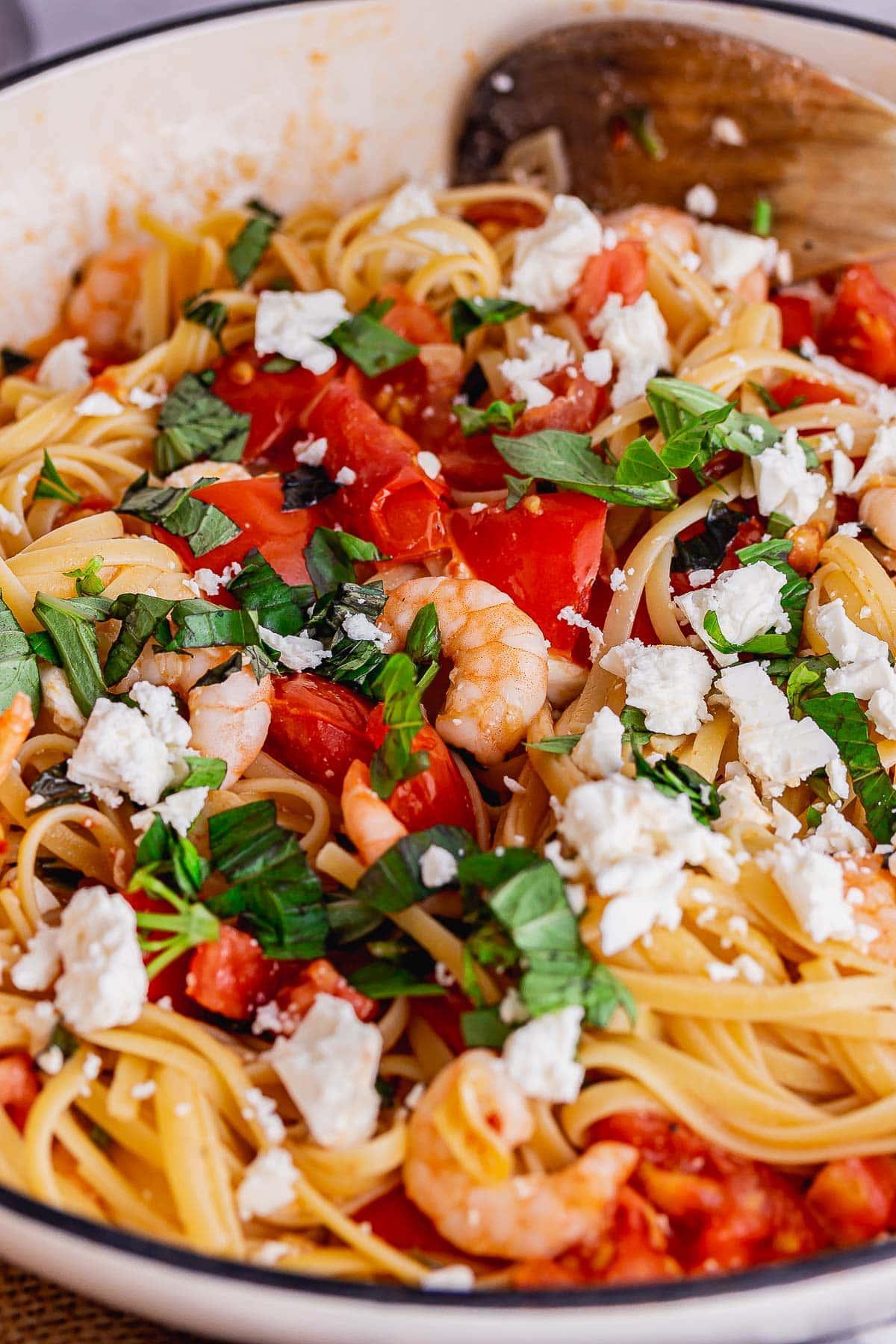 Pasta with tomato and feta in a cream dish