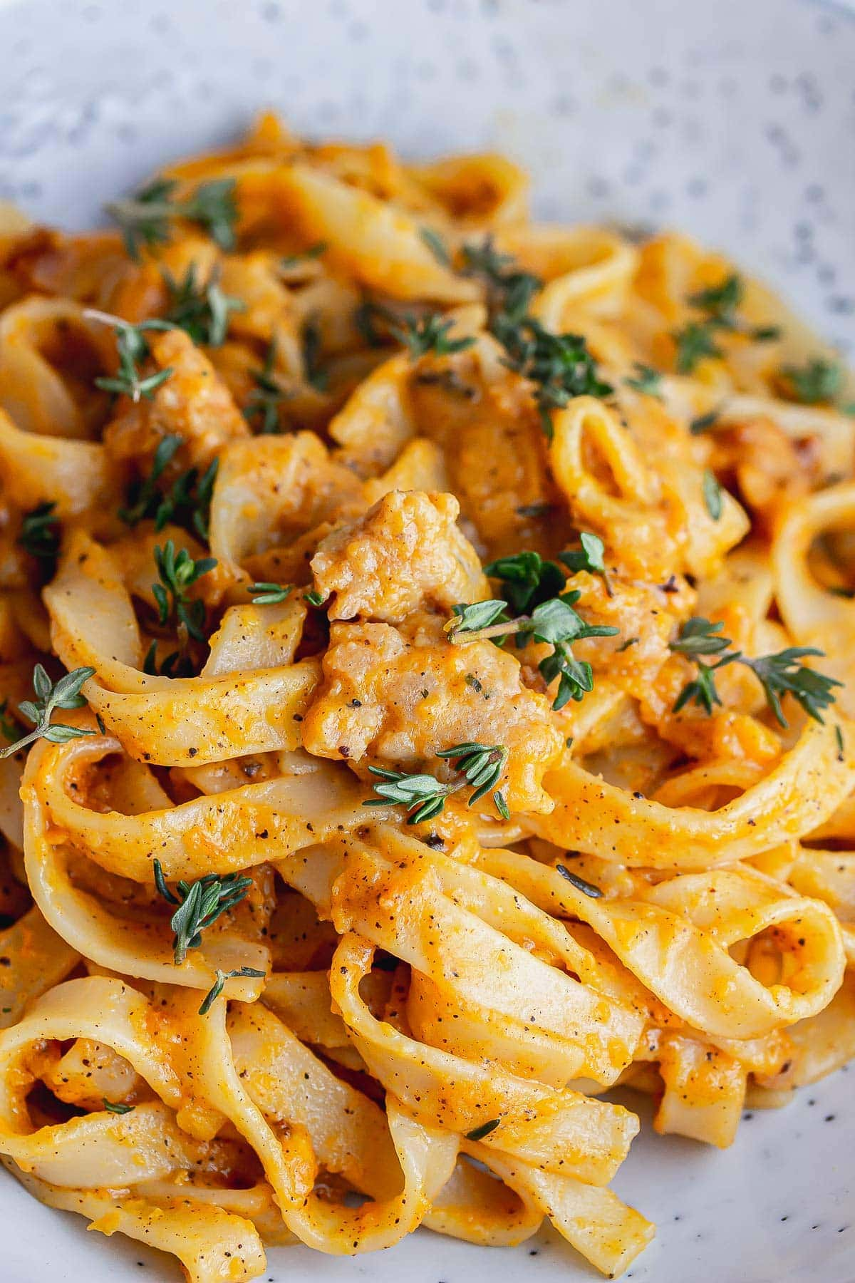 Close up of creamy squash and sausage tagliatelle