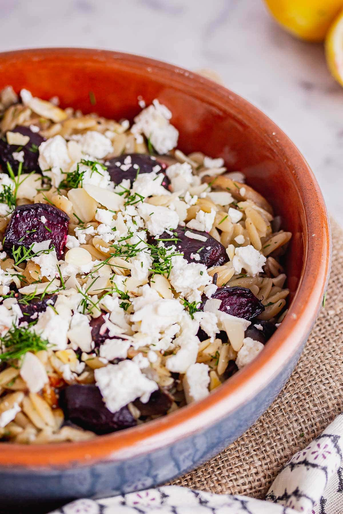 Blue bowl of feta and beetroot orzo