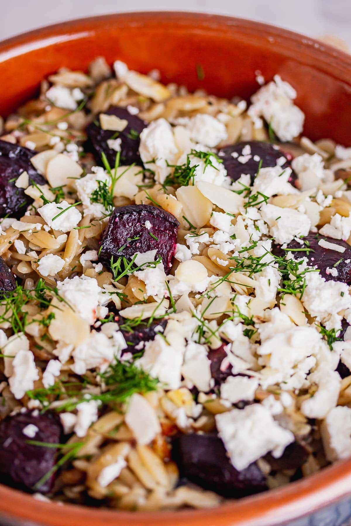 Close up of beetroot and feta orzo