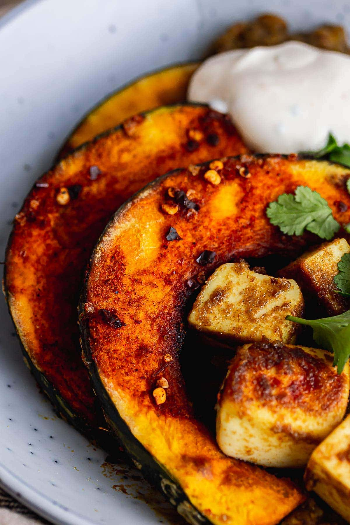 Close up of caramelised squash with yoghurt