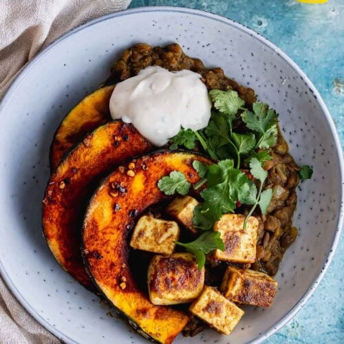 Overhead shot of squash and paneer on lentils