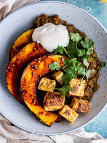 Overhead shot of spicy lentils with squash and paneer