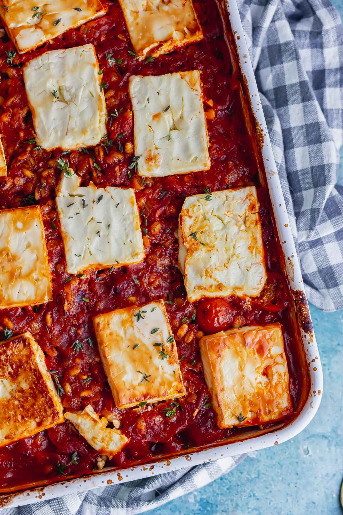 Cheese and tomato bake on a checked cloth