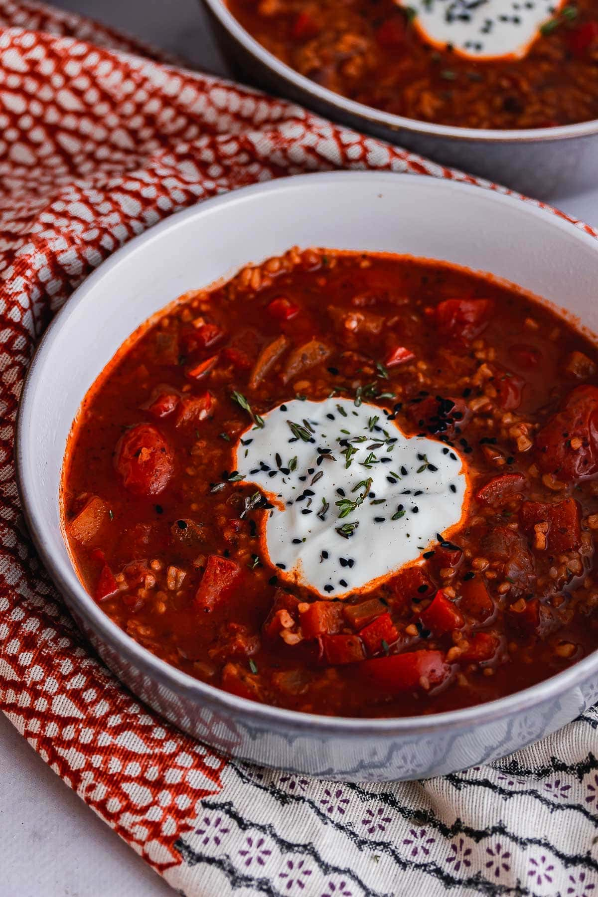 Grey bowl of spicy soup with yoghurt