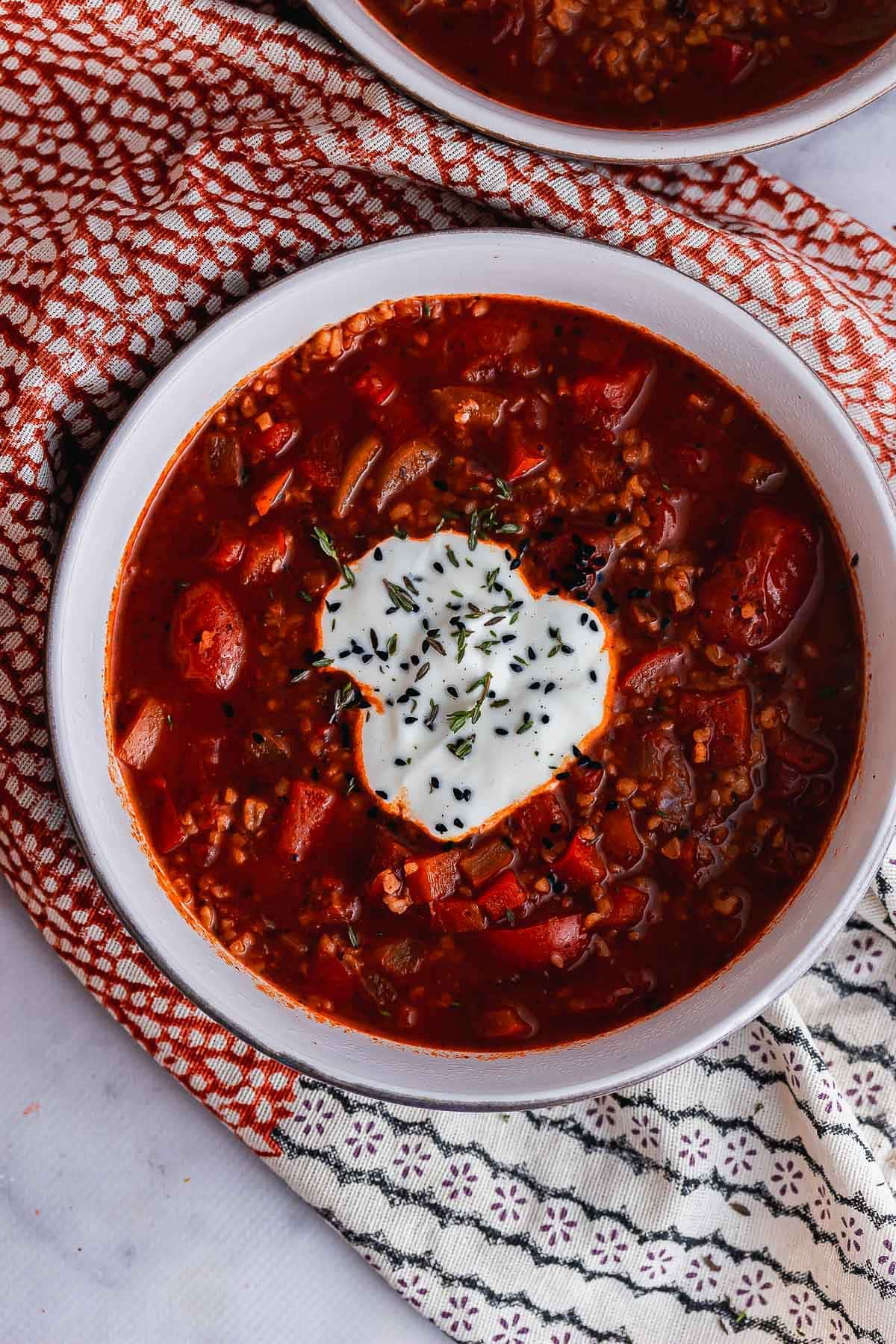 Overhead shot of spicy tomato soup with yoghurt