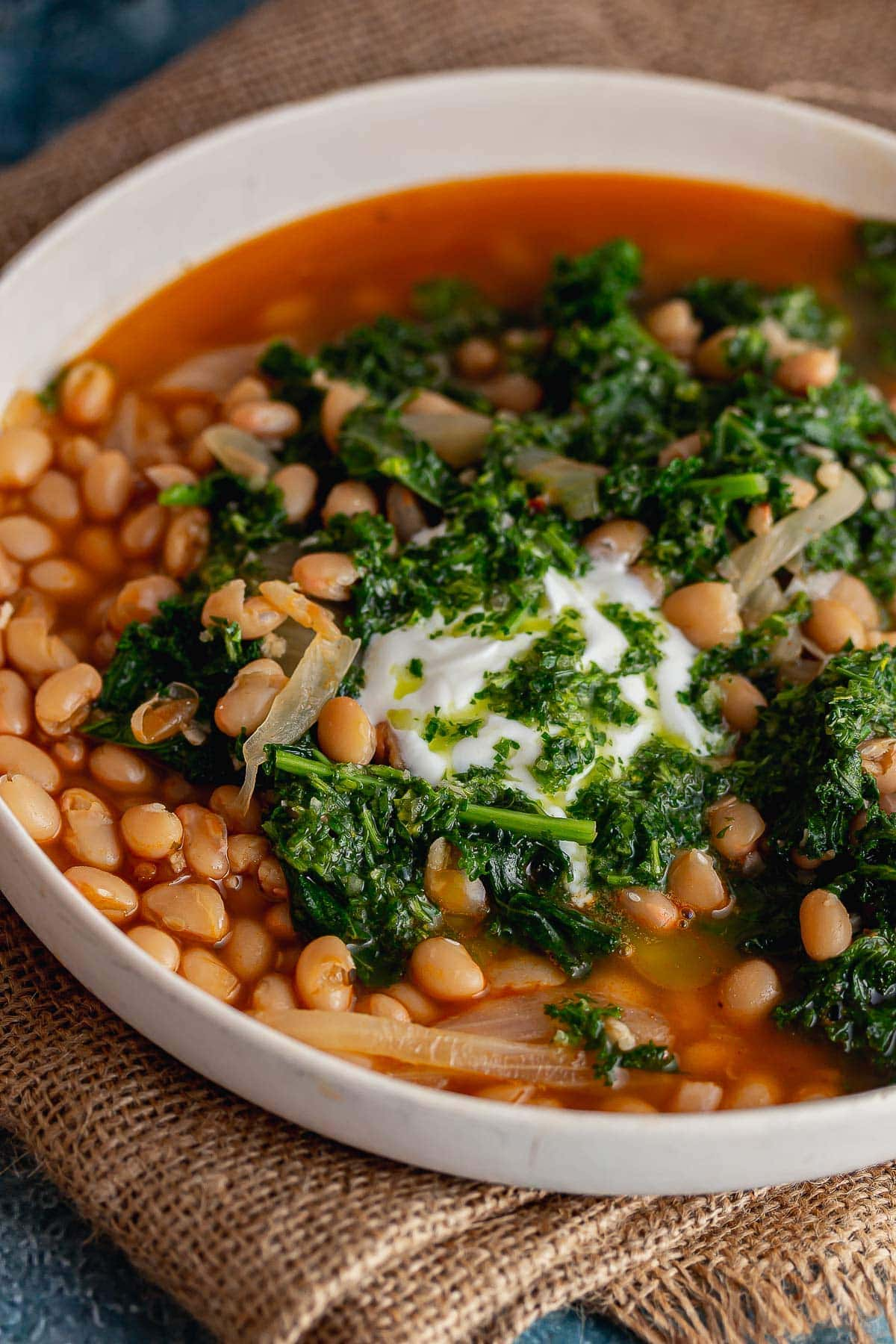 Close up of white bean soup with kale