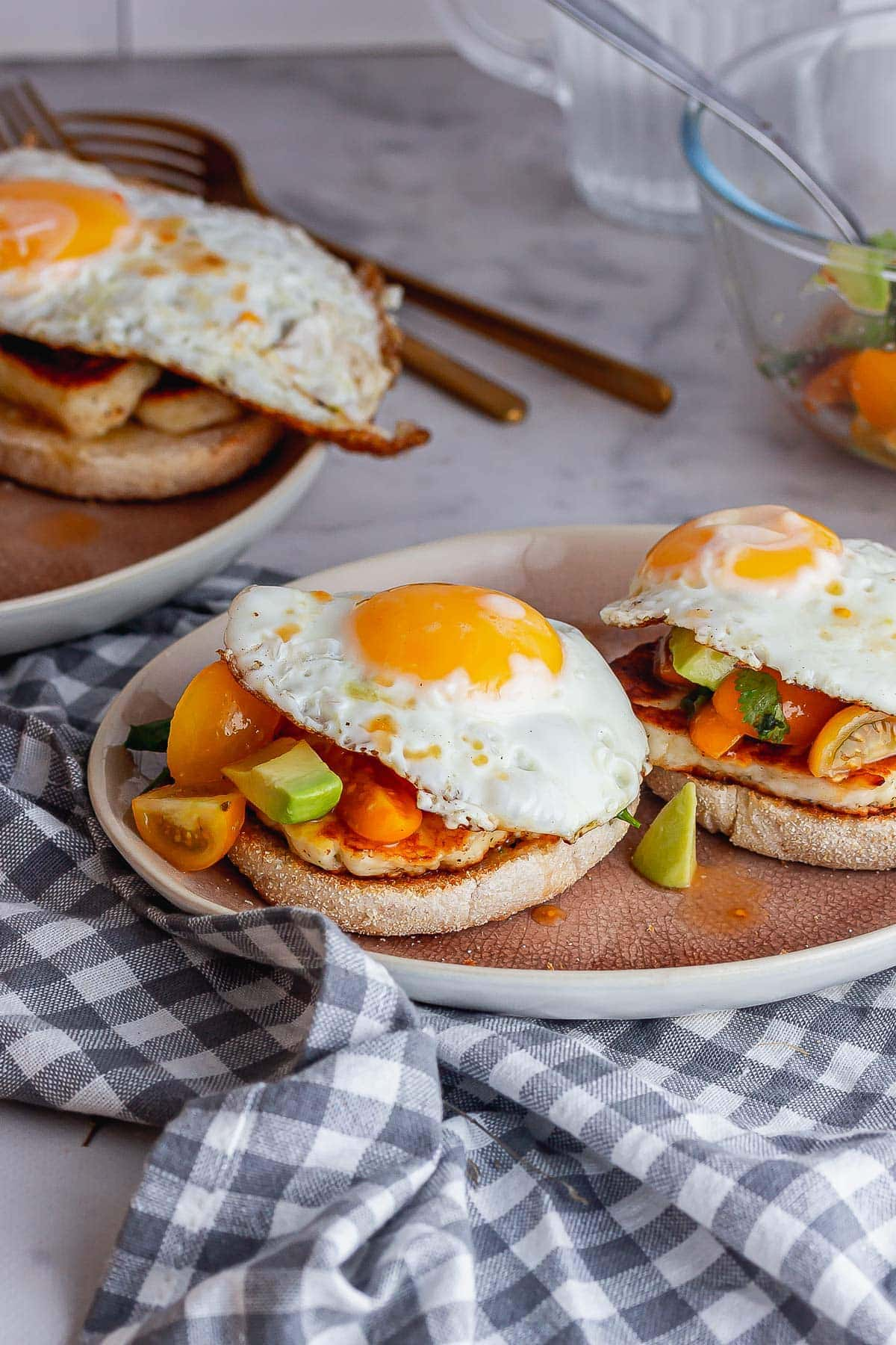 Halloumi muffins with eggs on a checked cloth