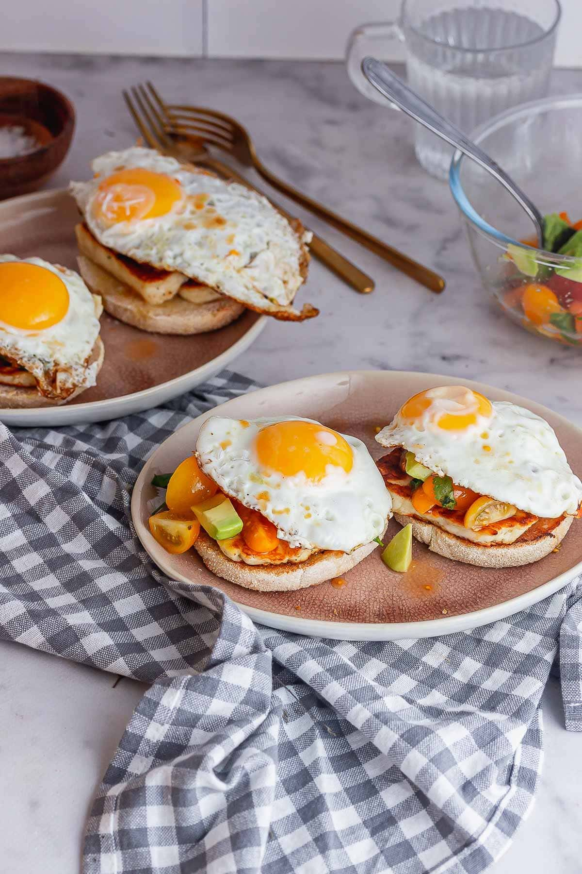 Plates of brunch muffins on a marble background