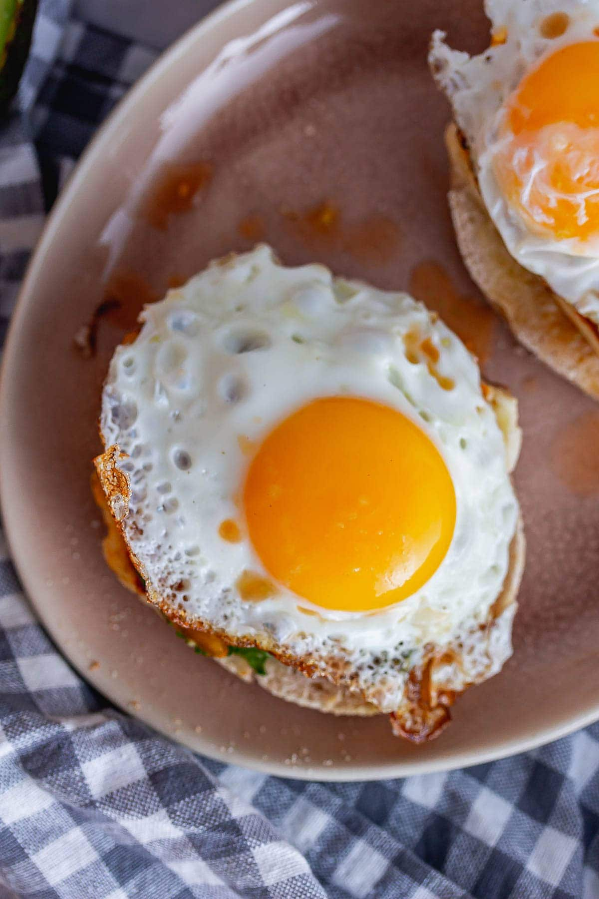 Overhead shot of a fried egg on a pink plate