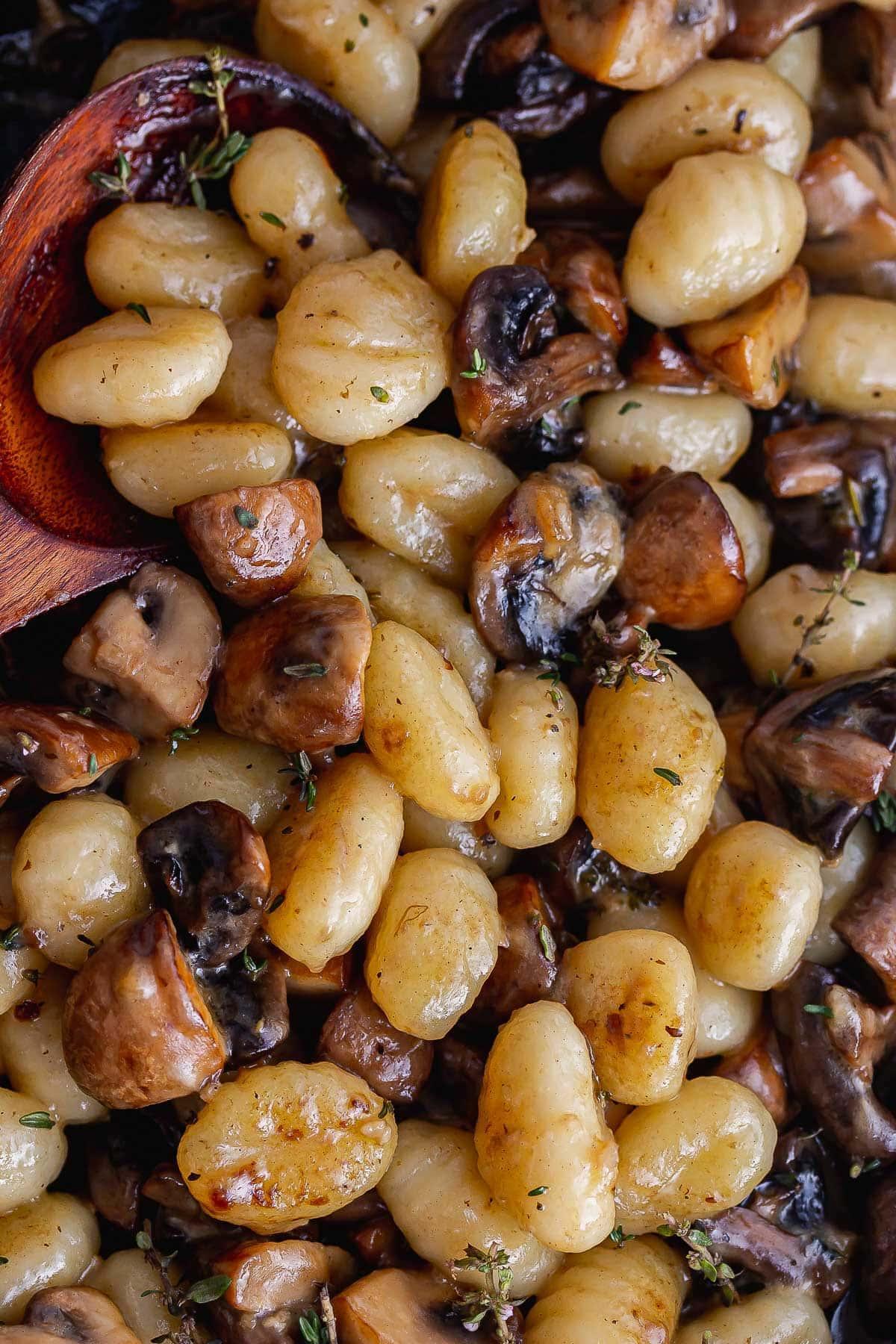 Overhead close up of gnocchi and mushrooms