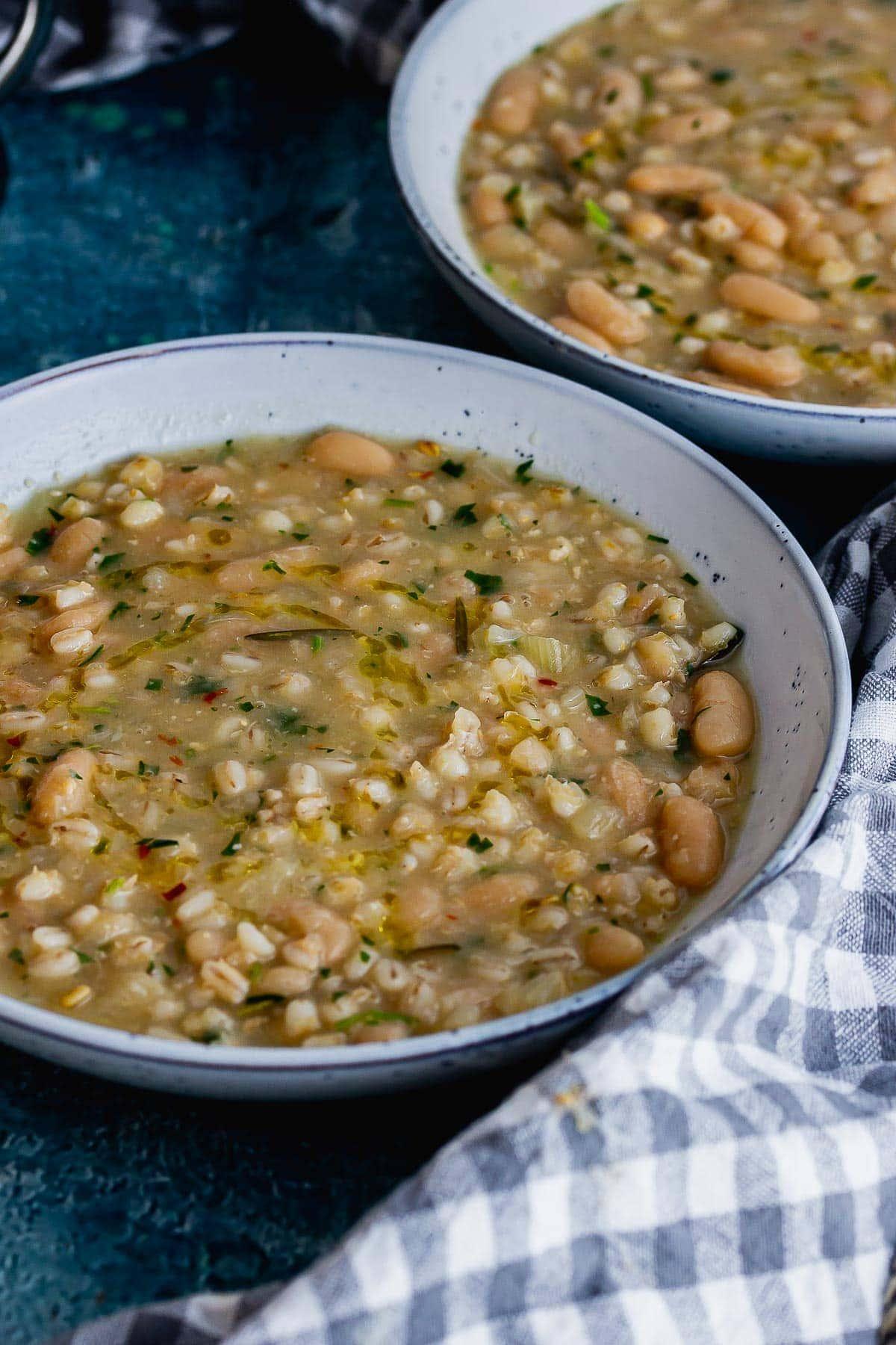 Blue bowl of bean and barley soup