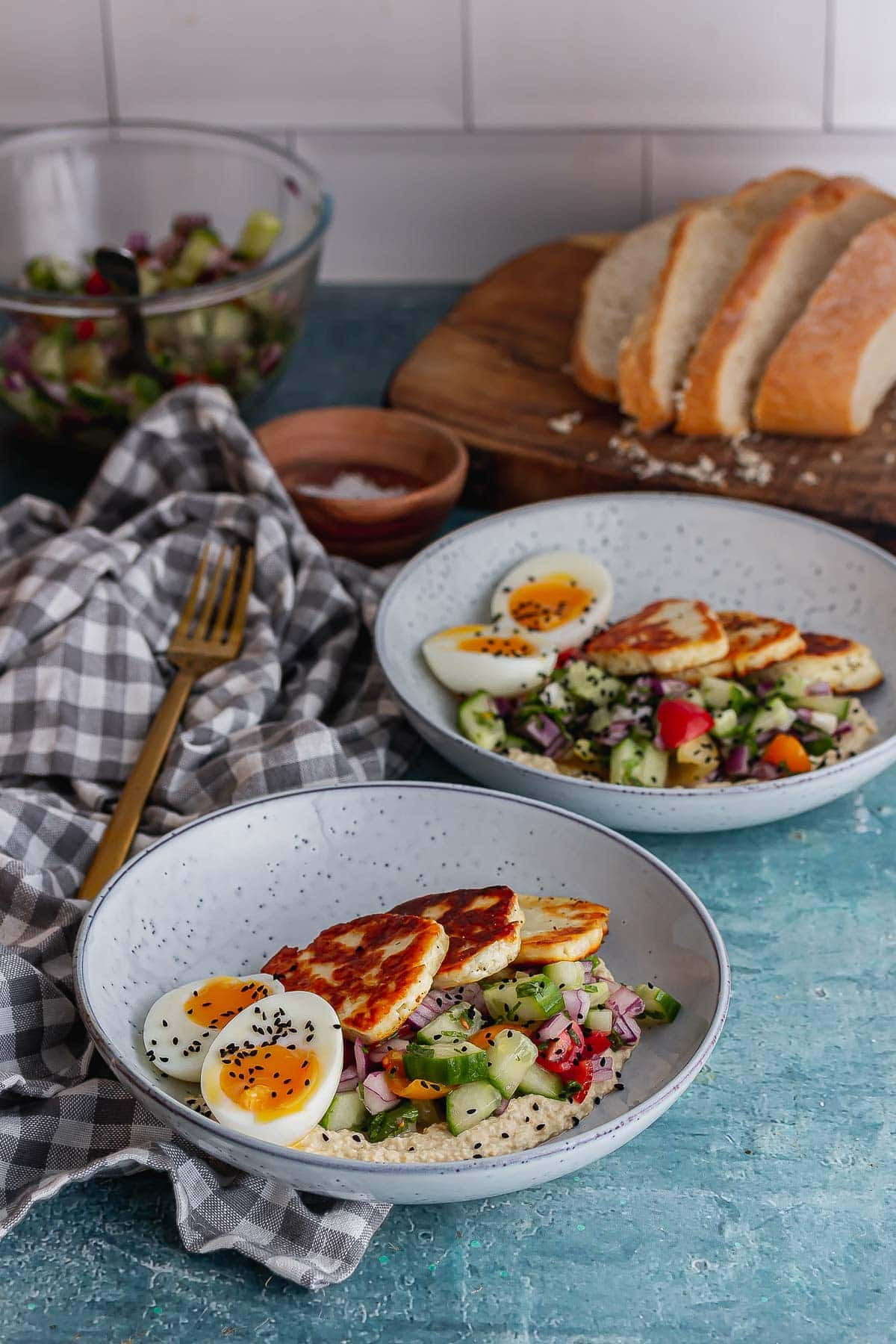 Bowls of halloumi breakfast bowl on a blue background