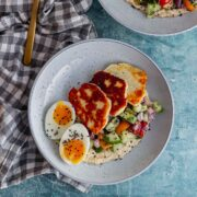 Overhead shot of halloumi breakfast bowl on a checked cloth