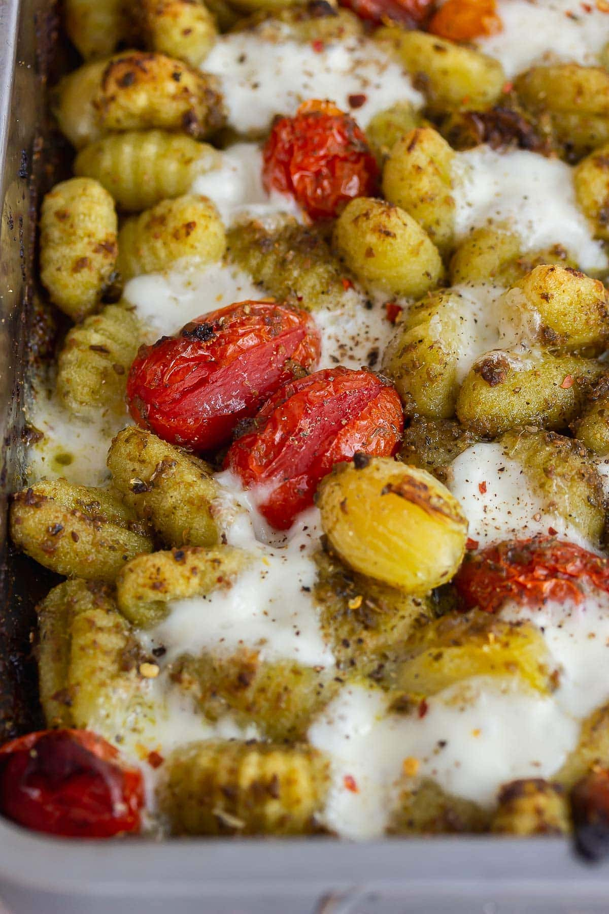 Close up of sheet pan gnocchi with tomato